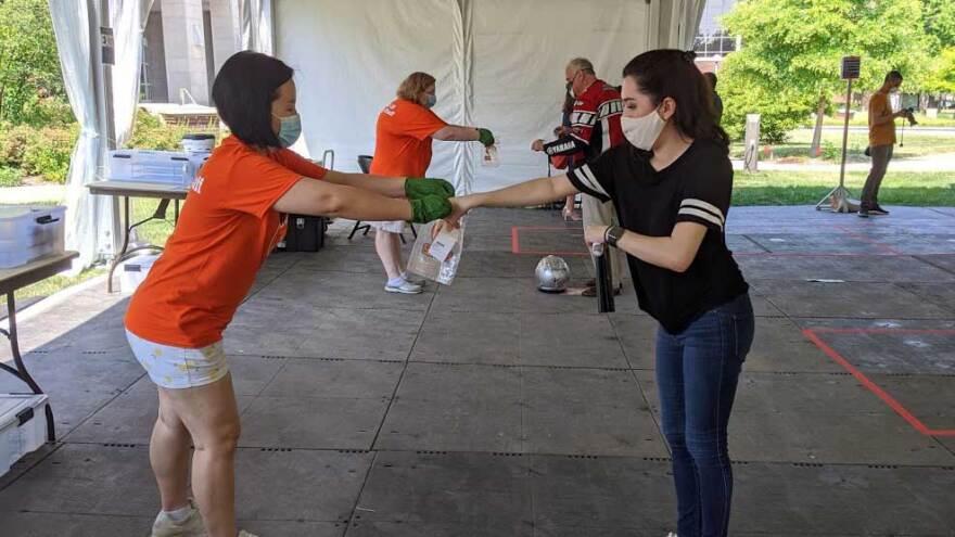 University of Illinois graduate student Kristen Muñoz submits her saliva sample for COVID-19 testing on the Urbana campus.