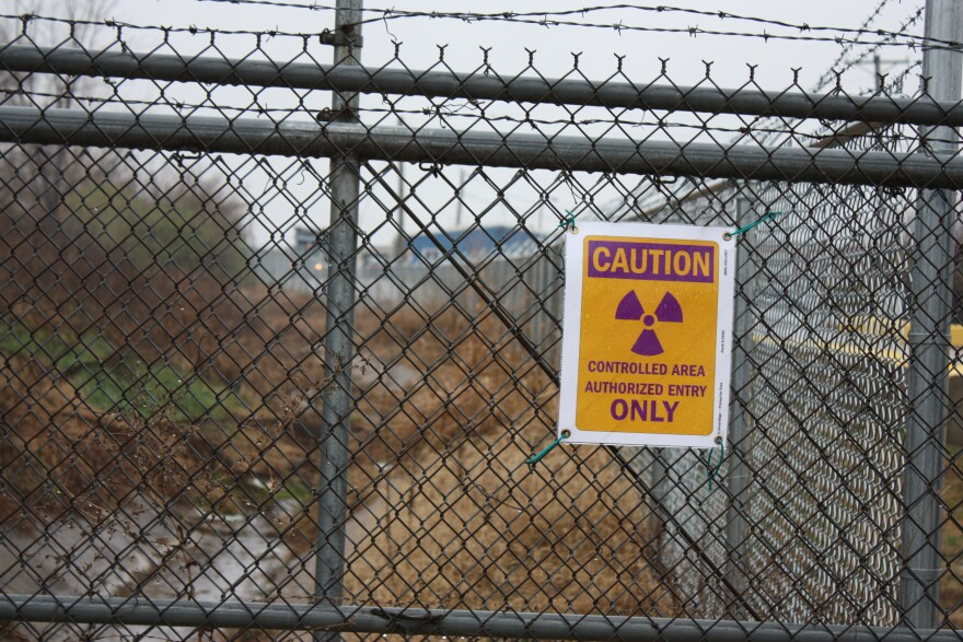 This radiation warning sign is one of many posted on the chain link fence surrounding part of the West Lake Landfill in Bridgeton, Mo.