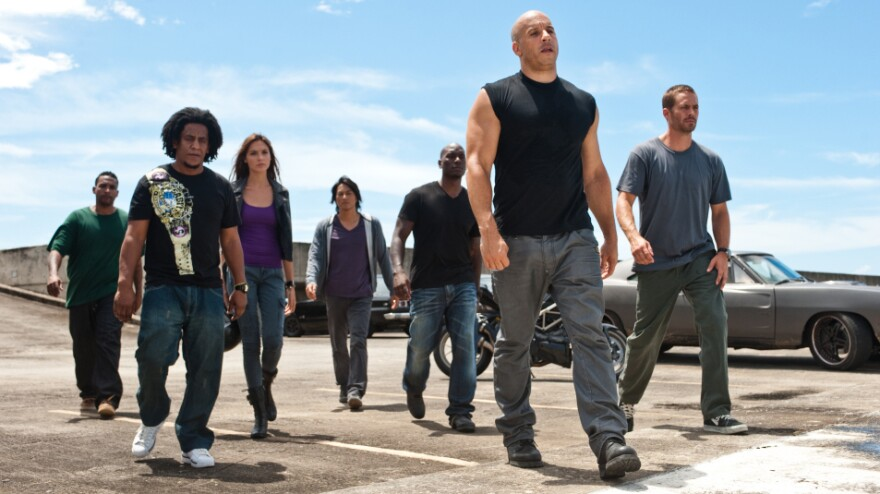 The cast of <em>Fast Five</em>, the latest film in the <em>Fast and the Furious</em> franchise.