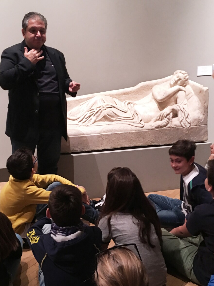 Lt. Sebastiano Antoci tells a fifth grade class visiting Rome's Palazzo Barberini museum how the art squad rescued an ancient statue.