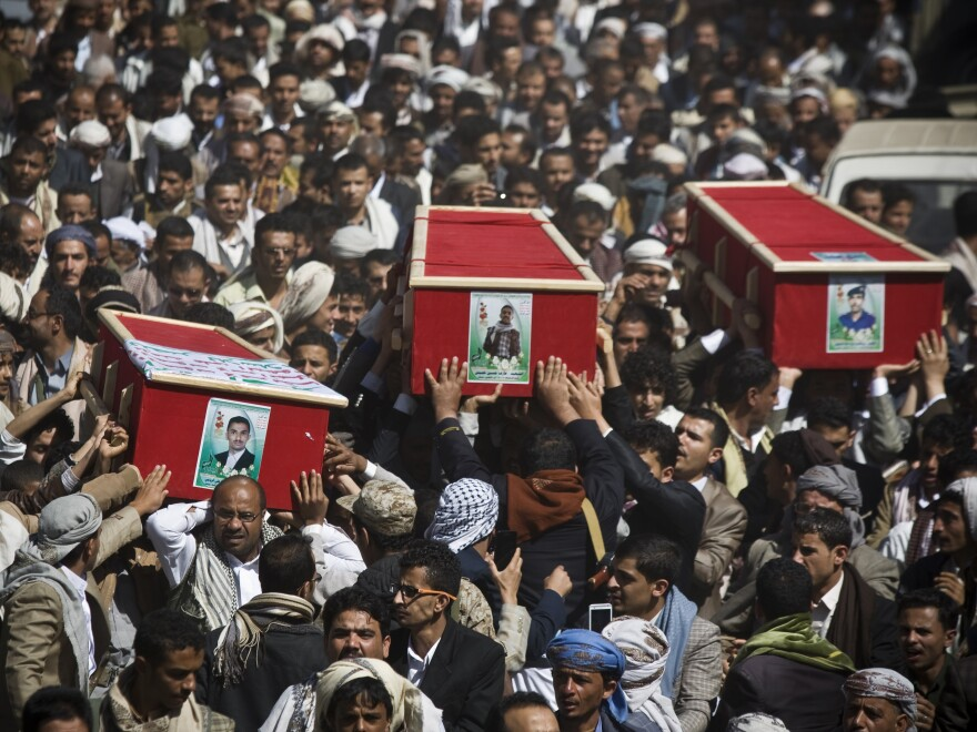 Houthi Shiite Yemeni carry coffins of fellow men killed during recent clashes with presidential guard forces, during their funeral procession in Sanaa, Yemen, on Friday.