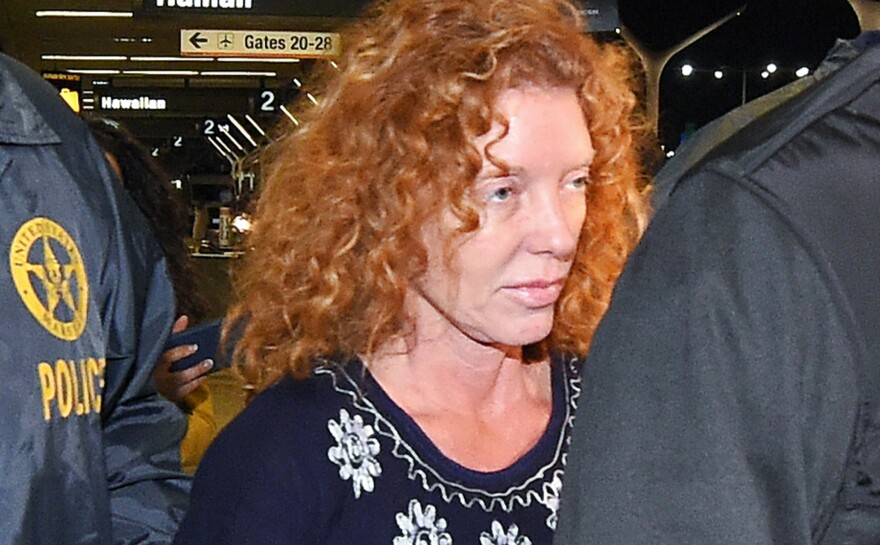 Tonya Couch is taken by authorities to a waiting car after arriving at Los Angeles International Airport on Thursday.
