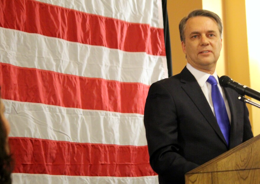 colyer_swear_in_podium_flag.jpg