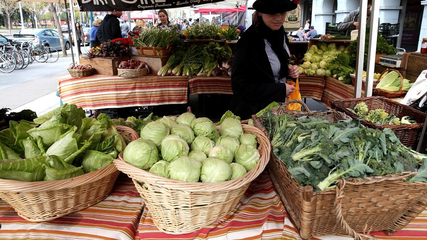A customer shops for produce at the Ferry Plaza Farmers Market on March 27th, 2014 in San Francisco.
