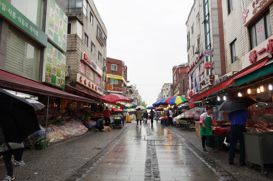 """""""Multicultural Street"""" in Wongok Village features stores, restaurants and stalls that serve the international community."""