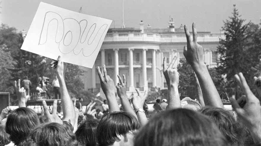 "Anti-Vietnam War demonstrators hold up signs and raise their hands toward the White House in a protest. The term ""baby boomers"" stuck for this generation because of their tumultuous youth."