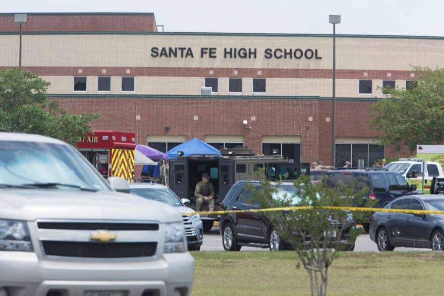 Emergency crews gather in the parking lot of Santa Fe High School after the shooting.