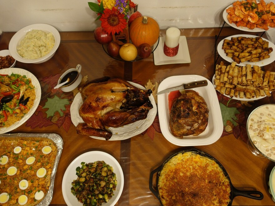 PJ Policarpio's Thanksgiving spread, last year. The feast includes Filipino paella, a noodle dish called palabok and lumpia, fried egg rolls.