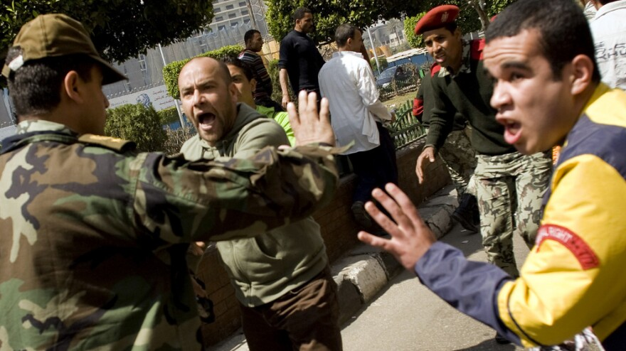 An Egyptian soldier argues with protesters during a rally in Cairo's Tahrir Square in March against proposed constitutional amendments. Many in Egypt now say that the military, once embraced by anti-government protesters who forced President Hosni Mubarak from office, is bypassing civilian laws and courts.