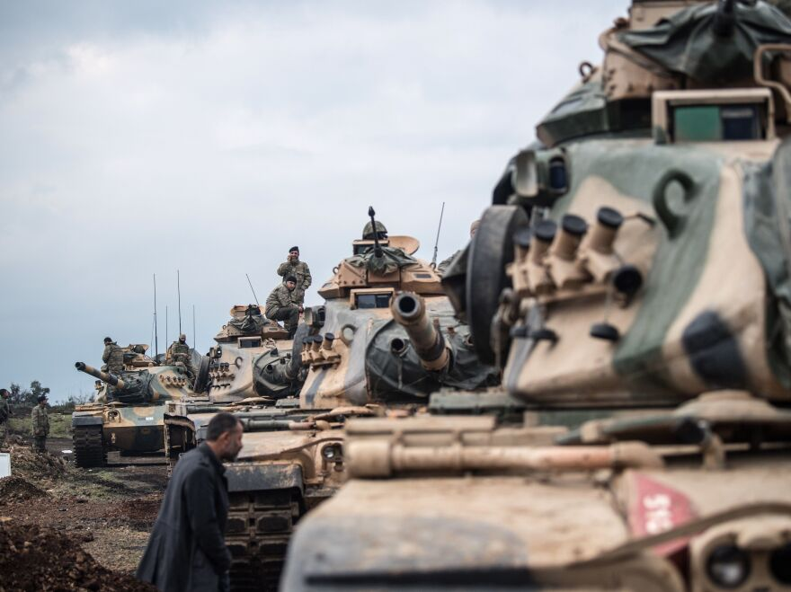 Turkish army tanks gather close to the Syrian border on Sunday.