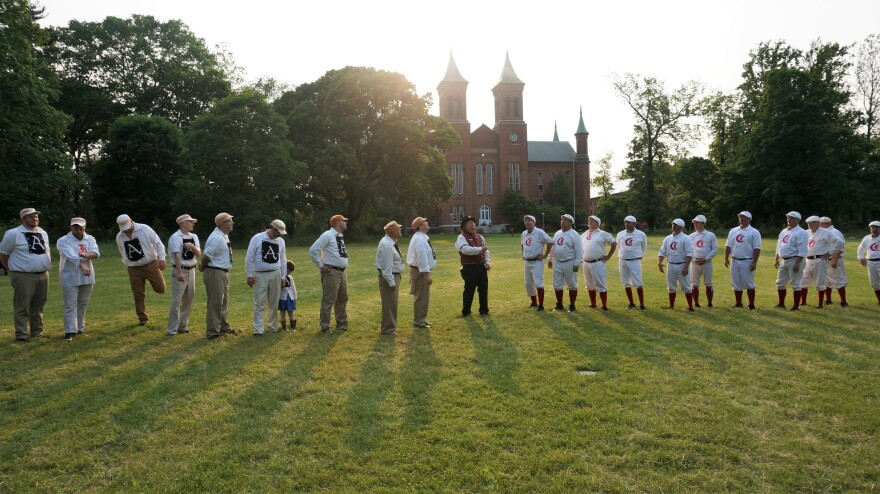 When base ball started out, it was two words, and the visitors didn't always bat first. Instead, there was a coin flip, like the one seen here before the Red Stockings played the Antioch Nine at Antioch College in Yellow Springs earlier this summer.