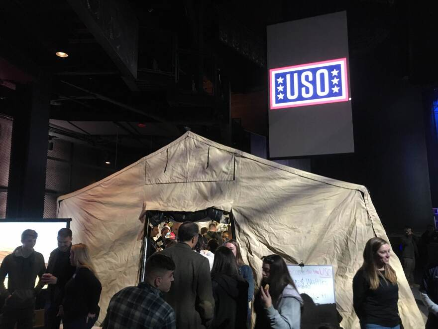 Service members play a video game inside the USO tent. At <strong></strong>the D.C. event, the organization invited about 400 civilians who were given a rare glimpse of military life.