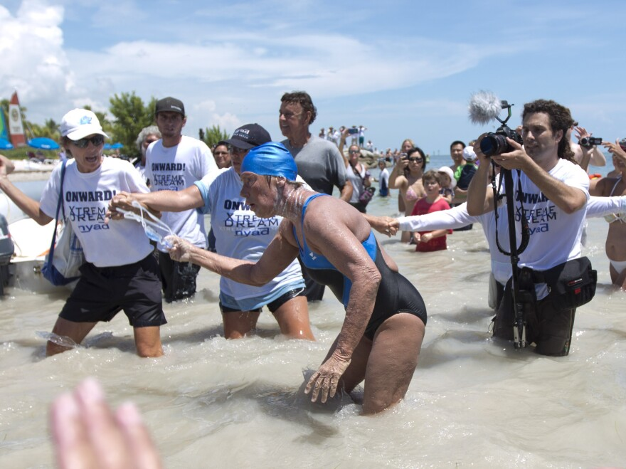 Diana Nyad struggles to come ashore in Key West on Sept. 2, 2013, after completing her swim from Cuba.