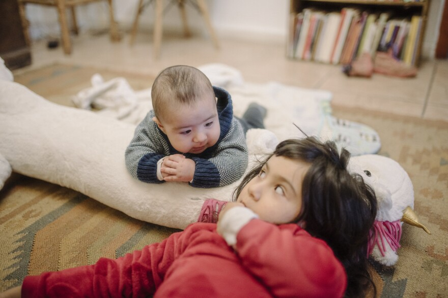 """Paz Olivares-Droguett made this picture on the day that marked 3 months of confinement to home: """"The relationship between Amadeo and Eleonora, our firstborn, has been growing — and they are, too."""" <em>June 2. Valparaíso, Chile.</em>"""