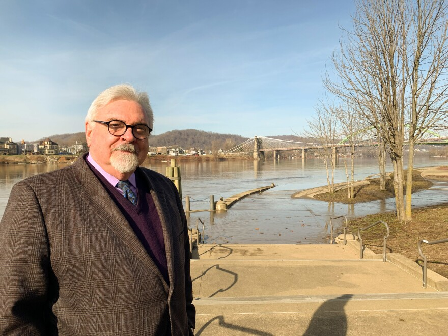 "Patrick Cassidy, a labor and employment lawyer in Wheeling, W.Va., stands along the Ohio River. ""When I see the Ohio Valley, even with the decline, I see opportunity."""
