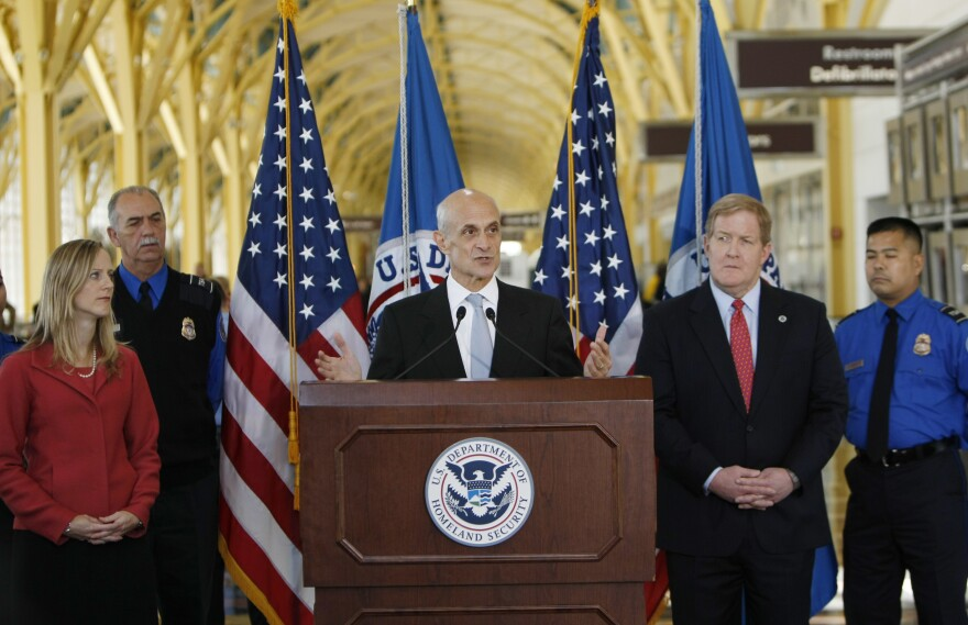 Kathy Kraninger, left, is seen in a 2008 photo, during her tenure the as Department of Homeland Security Deputy Assistant Secretary for Policy under Director Michael Chertoff, center.