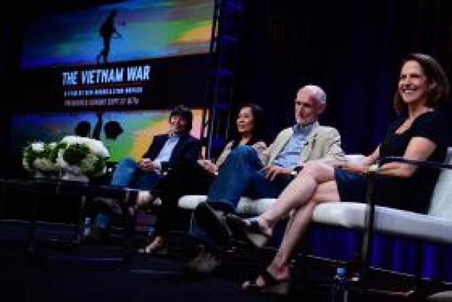 Filmmakers Ken Burns (far left) and Lynn Novick (far right) discuss their Vietnam War documentary at a TV critics event in July.