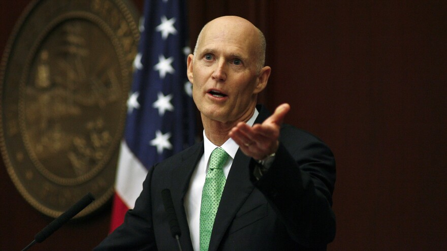 Florida Gov. Rick Scott recognizes a visitor in the gallery during his March 4 State of the State speech at the Capitol in Tallahassee.