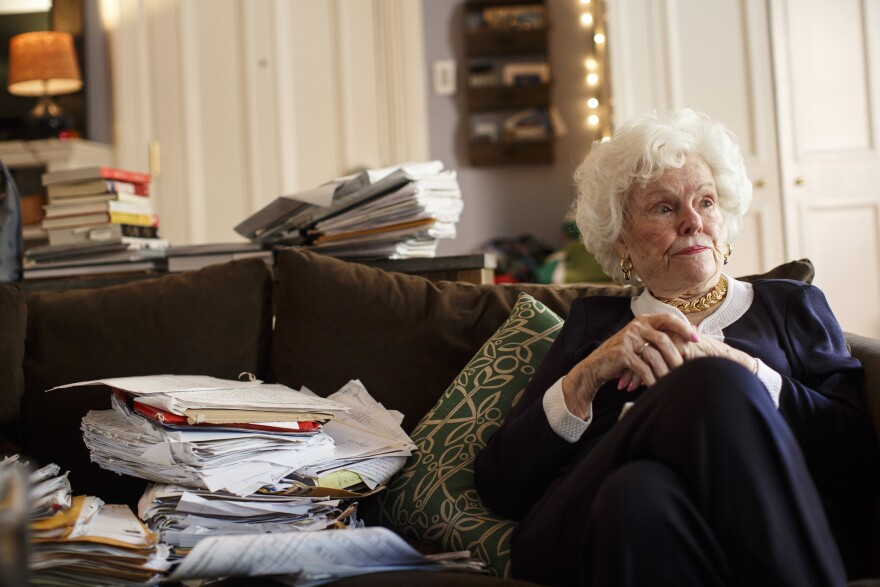 Doris Buffett, the late sister of Warren Buffett, sits with some of the letters Buffett received asking for help, and which inspired a foundation, in Boston on Aug. 2, 2016. The Letters Foundation, as it's known, applied for PPP funding and received nearly $270,000.