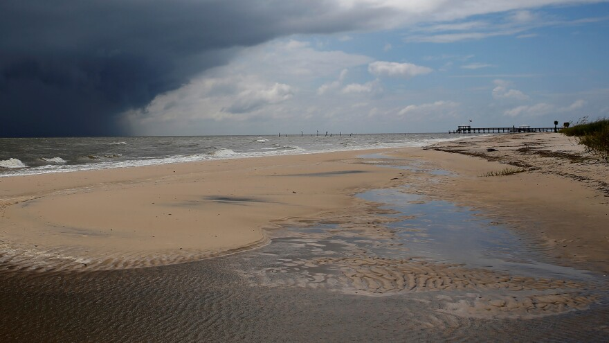 Waveland and other beaches in Mississippi are closed because of a large algae bloom along the coast. The beach is seen here last September, as storm clouds from Tropical Storm Gordon approached.