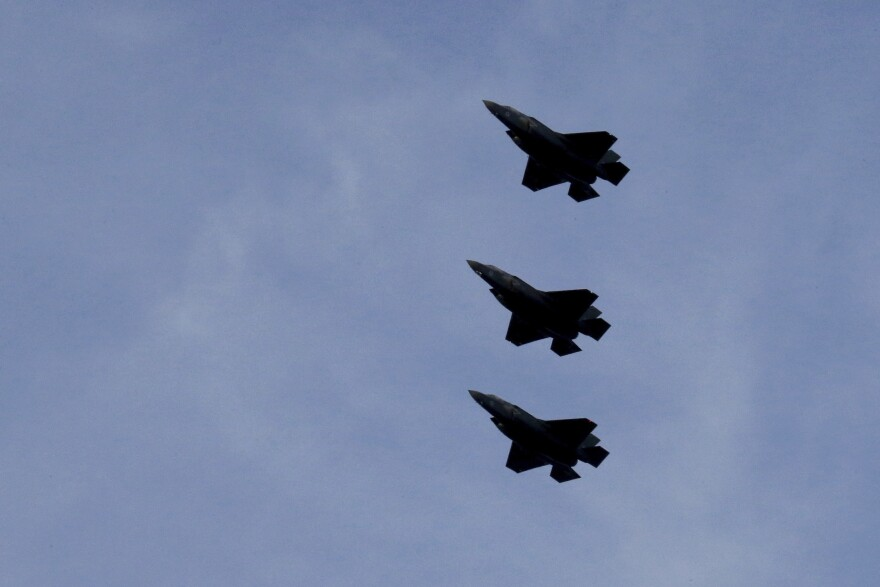 F-35B aircrafts fly over the Akrotiri Royal air forces base before landing.