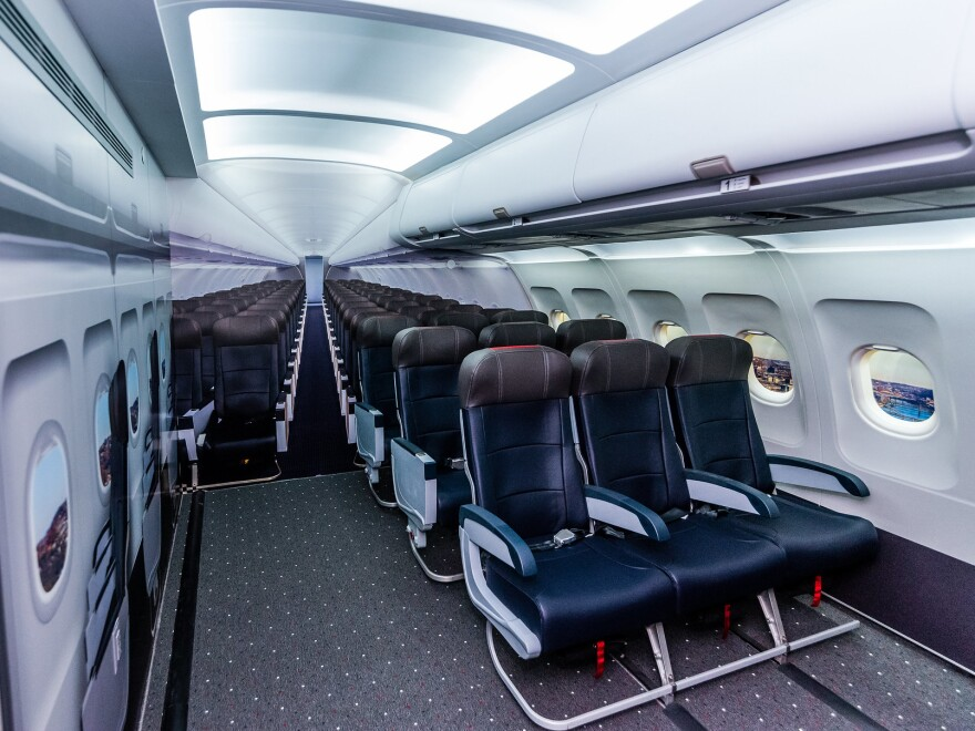 A replica of an airplane cabin in the sensory space includes airplane seats, trays, windows, seat belts and overhead compartments, to allow kids and adults to get used to the feeling of sitting on a plane.