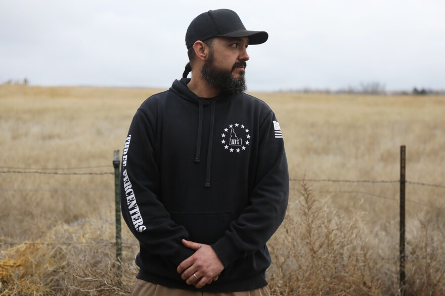 "Eric Parker of the Real 3%ers Idaho attends a convoy training exercise in western Idaho on Jan. 25. NPR has followed Parker's political evolution as he joins a wave of ""patriot movement"" figures seeking – and sometimes winning – public office."