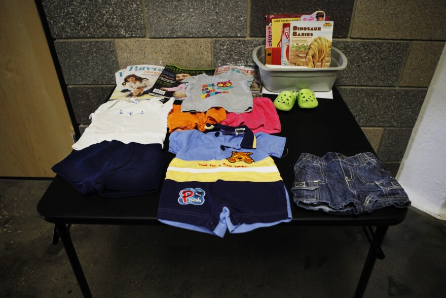 A table of giveaways in the hallway outside Scavo's day care, Teddy Bear Town.