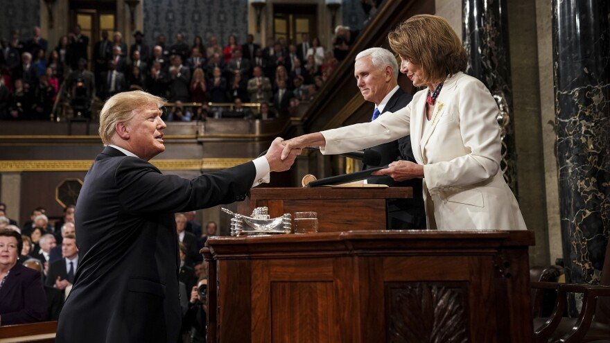 President Trump shakes hands with House Speaker Nancy Pelosi as Vice President Pence looks on in the House chamber before giving his State of the Union address to a joint session of Congress on Feb. 5, 2019.