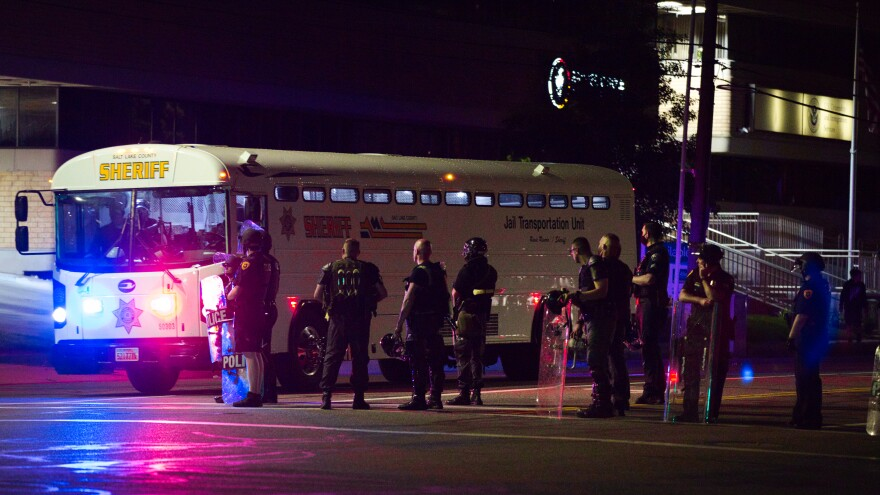 Photo of SLCPD and bus.