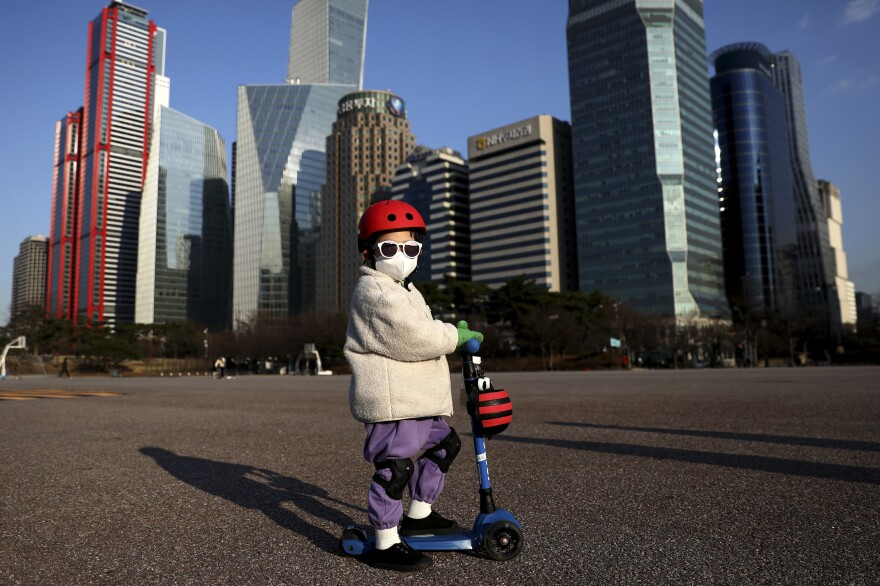 A South Korean child rides a scooter on Feb. 27 in Seoul.