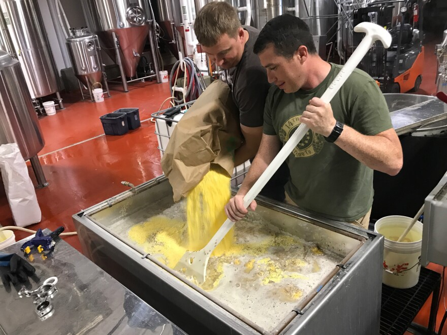 Zac Fike (L) and Matt Kehaya (R) work on a batch of beer at 14th Star Brewing Company. 14th Star donates some of its proceeds to local nonprofits.