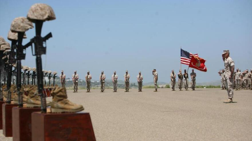 <p>Marines with 3rd Battalion, 5th Regiment salute during the playing of taps at a memorial ceremony on April 29 at Camp Pendleton, Calif. Moments before, the Marines fired a 21-gun salute in honor of the 25 fallen warriors of the battalion.</p>