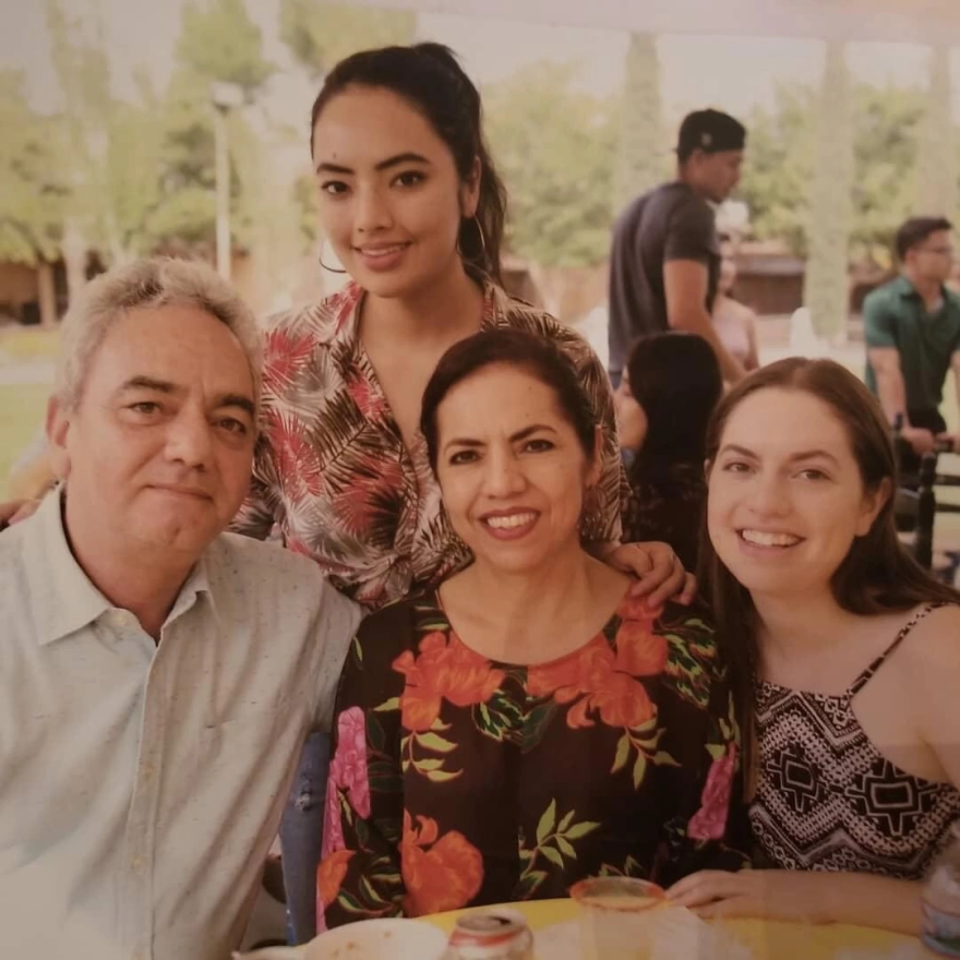 Ana Hernandez (standing) and younger sister Claudia (far right) are among voters on the Texas-Mexico border who have strong ties to both sides. The Hernandez sisters, who live in El Paso, are pictured in a family photo with their parents in Ciudad Juarez.