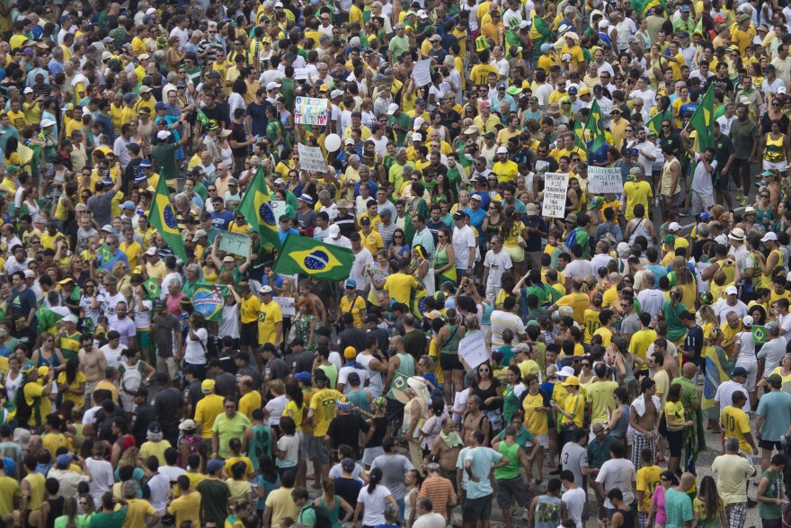 People gather in Copacabana beach during a protest against Brazil's President Dilma Rousseff in Rio de Janeiro, Brazil, on Sunday.