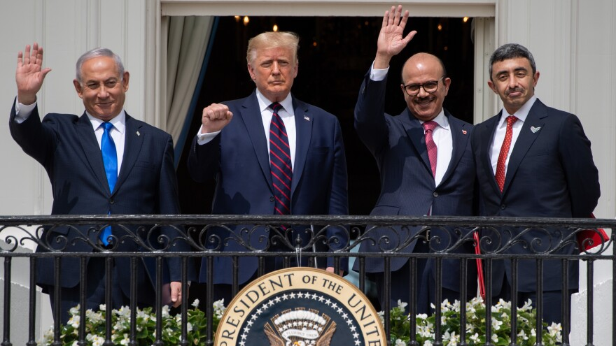 Israeli Prime Minister Benjamin Netanyahu (from left), President Trump, Bahraini Foreign Minister Abdullatif bin Rashid Al Zayani and Emirati Foreign Minister Abdullah bin Zayed Al Nahyan wave from the Truman Balcony at the White House. The group participated in the signing of the Abraham Accords on Tuesday.