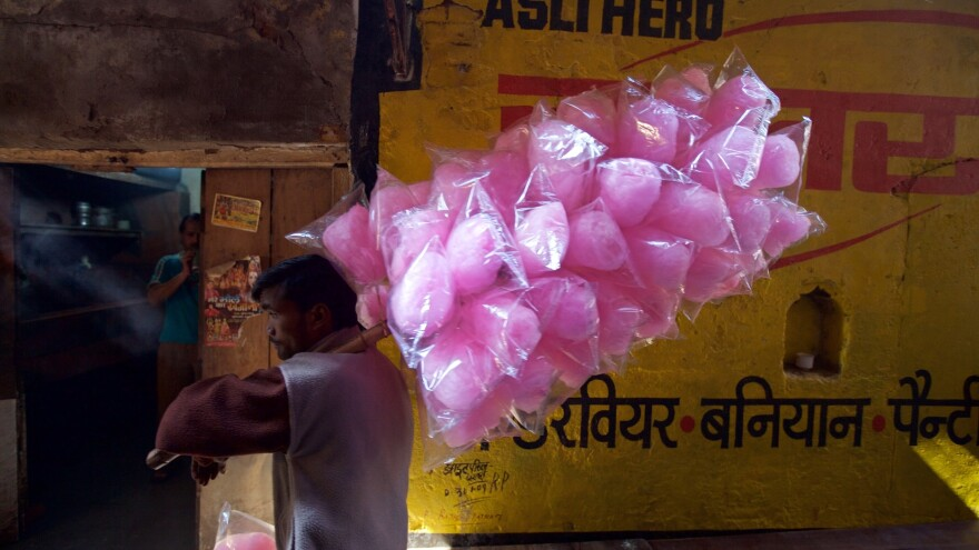 India's sweet tooth has been pegged as a factor in the country's rising rate of diabetes. Above: a cotton candy vendor in Haridwar.