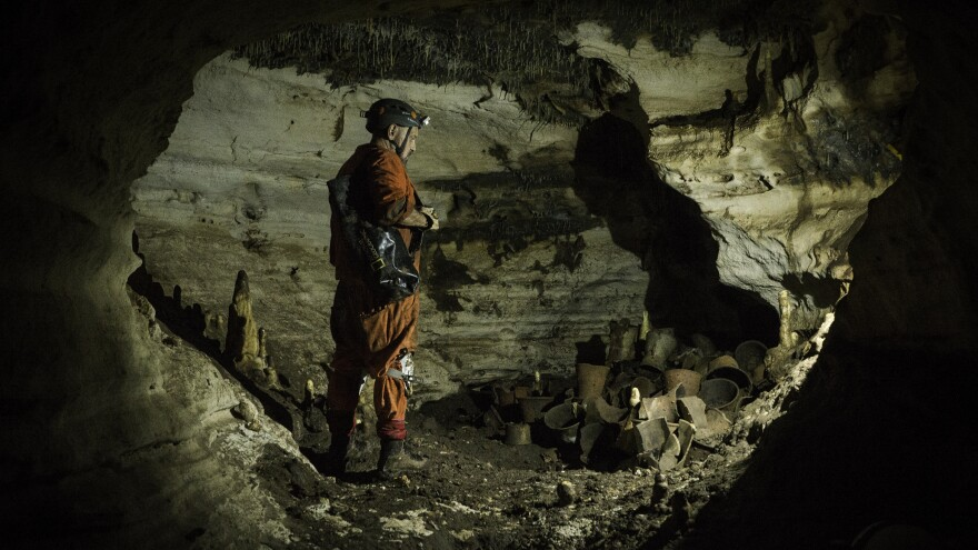 Archaeologist Guillermo de Anda checks out the third group of discovered archaeological materials in the cave.