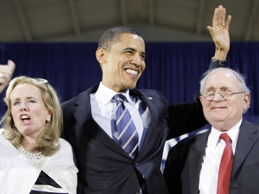 Debbie Dingell with Michigan Sen. Carl Levin and then-presidential candidate Barack Obama during a 2008 campaign event in Flint, Mich. Dingell is expected to announce Friday that she will run for her husband's House seat.