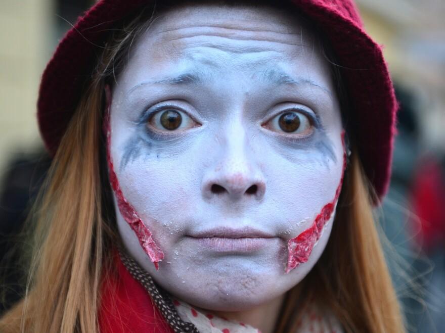 "So sue me! (A ""zombie"" who came to protest the government in Ljubljana, Slovenia, in February.)"