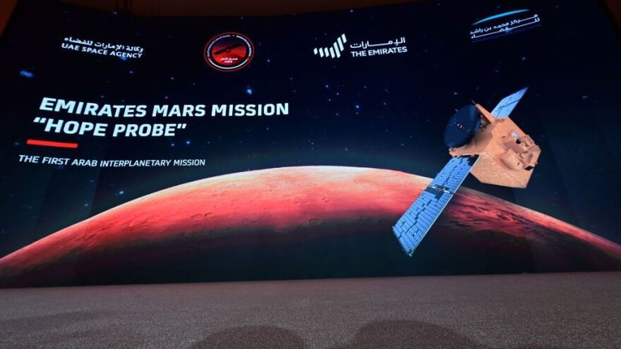 "A picture taken on July 19, 2020, shows a screen broadcasting the launch of the ""Hope"" Mars probe at the Mohammed Bin Rashid Space Centre in Dubai. ""Hope"" — Al-Amal in Arabic — is expected to start orbiting Mars this week, marking the 50th anniversary of the unification of the UAE."