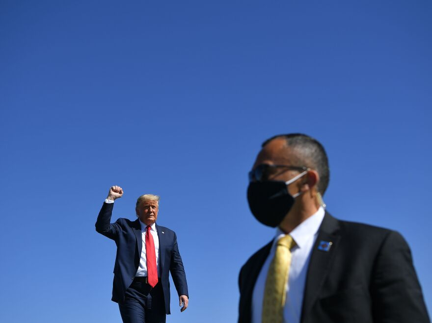 President Trump arrives to speak during a rally at Prescott Regional Airport in Prescott, Ariz., Monday.