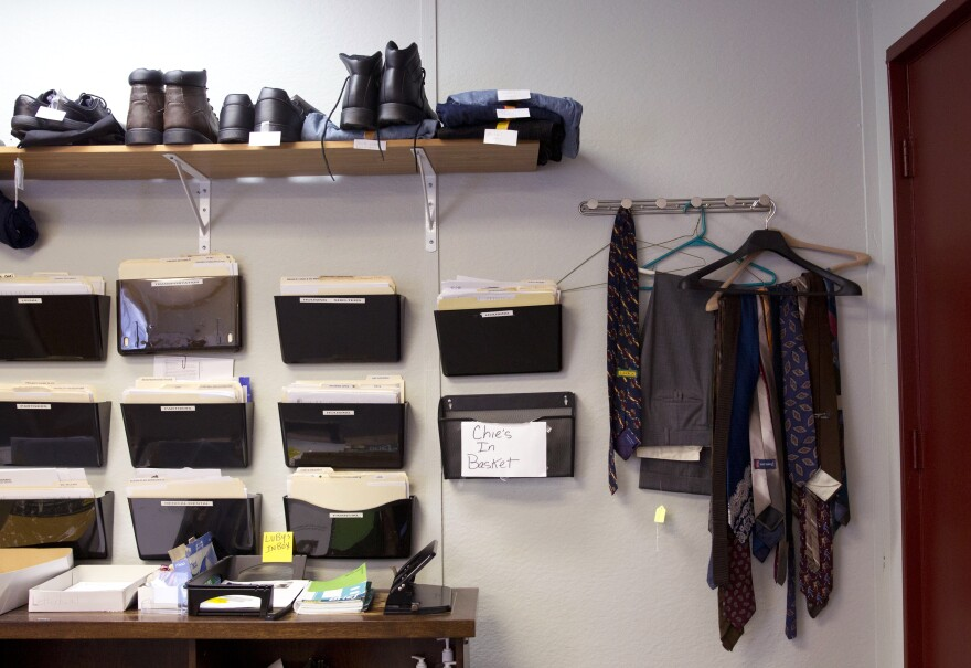 Work and interview clothes hang in the Reentry Transition Center office, available as needed for program participants.