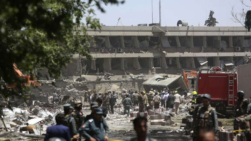 Security forces inspect the site of a massive explosion in a busy area not far from the German Embassy in Kabul, Afghanistan, on Wednesday.