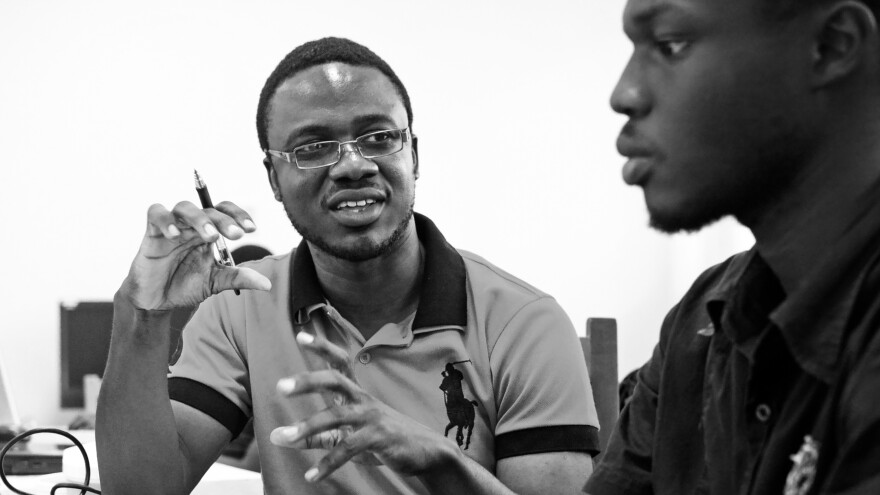 Kpetermeni Siakor (left), a Liberian who is studying in Ghana, used crowdsourcing software to help out during the Ebola epidemic.