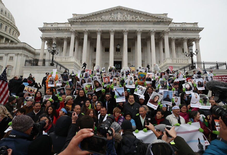 People who call themselves DREAMers protest in front of the Senate side of the U.S. Capitol to urge Congress in passing a legislative fix for the Deferred Action for Childhood Arrivals (DACA) program, on December 6, 2017, in Washington, D.C.