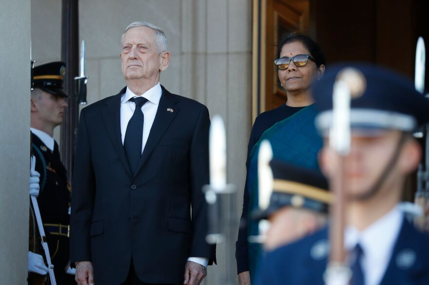 Then-Defense Secretary Jim Mattis stands with the defense minister of India, Nirmala Sitharaman, moments after the Indian dignitary arrived at the Pentagon earlier this month.
