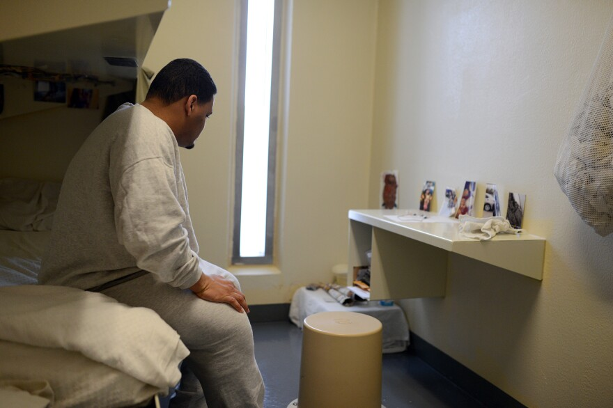 Eric Darden sits in his cell.