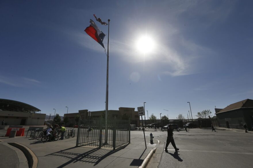 """A person crosses the street at a U.S.-Mexico border crossing in El Paso, Texas, on March 29, 2019. Threatening drastic action against Mexico, President Trump declared on Friday he is likely to shut down America's southern border next week unless Mexican authorities immediately halt all illegal immigration. Such a severe move could hit the economies of both countries, but the president emphasized, """"I am not kidding around."""" (Gerald Herbert/AP)"""