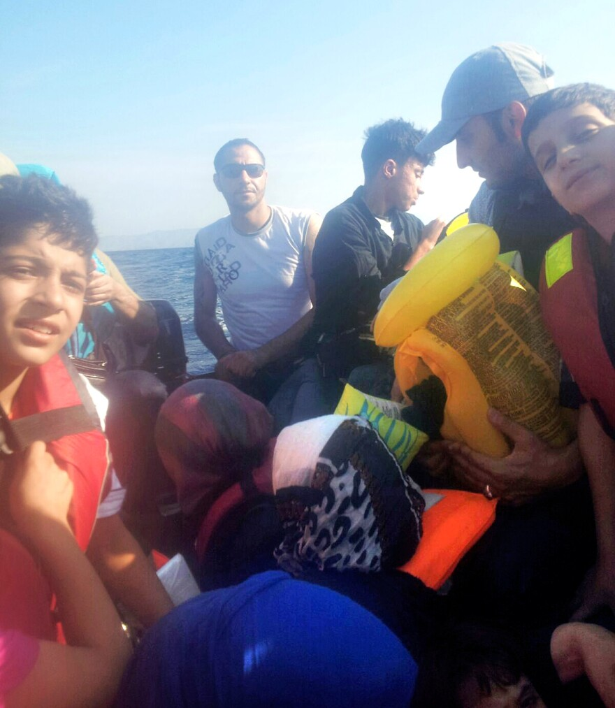 Refugees are crammed together on a raft during the journey from Izmir, Turkey, to Lesbos, Greece.